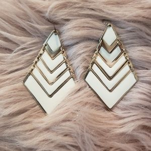 Gold and cream colored dangle earrings
